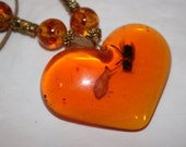 FREE SHIPPING amber colored lucite heart necklace with bugs inside