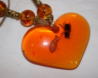 FREE SHIPPING amber heart necklace with bugs inside