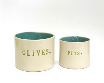olives and pits  ...  hand built porcelain containers ...  vessels