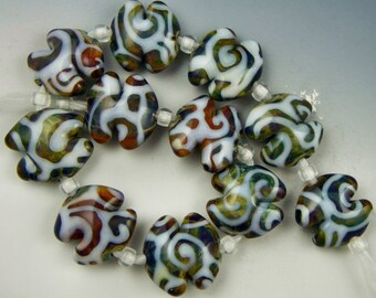 handmade lampwork glass bead set of 11 organiclly shaped semi-lentil beads in multicolored silverglass - Pods