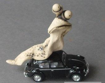Slug Bug - Whimsical Ceramic Sculpture on Toy VW Beetle (Black)