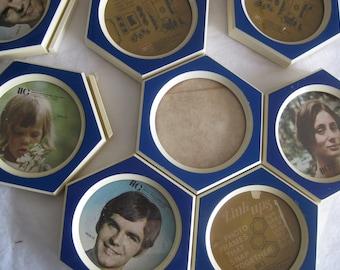 Vintage beehive like photo frames ensemble, 9 frames thak link together in any form you like.