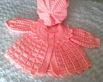 Baby Girls Coat and Hat set to fit a 6-12 Months Made in a peach coloured yarn