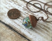Glass Acorn Necklace in Peacock Raku with attached Leaf by Bullseyebeads - READY TO SHIP