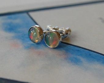 play of light. welo opal stud post earring.  6mm.  sterling silver.  AAA.  bezel set.
