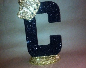 Sparkle letters with crown.  Table numbers can be done as centerpieces, decorations, etc.