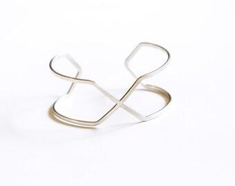"Distinctive geometric wire bracelet handformed using sturdy flattened 12 ga silver wire into a striking minimalist design - ""Crossings Cuff"""