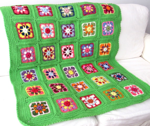 Handmade Crochet Kaleidoscope Baby nursery blanket  / afghan granny squares. Approximately 3 feet 6 inches by 3 feet