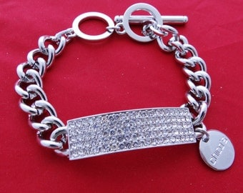 "Vintage CHICO signed silver  tone 8"" bracelet with sparkly rhinestones and toggle clasp in great condition, appears unworn"