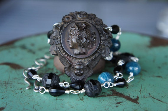 Antique Assemblage Necklace with Vulcanite Highly Detailed Neoclassical Woman and Cherub Pendant, Kyanite and Vintage Glass Beads