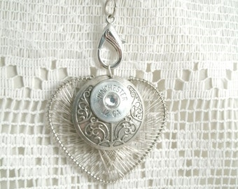 Repurposed Winchester 12ga Pendant on Metal base with Metal wire Heart Backing with glass Crystal Center