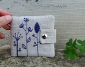 Wallet for woman with wild flowers. Embroidered wallet in sand and blue made of organic fabrics
