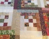 Custom finish order for Sandy's log cabin quilt