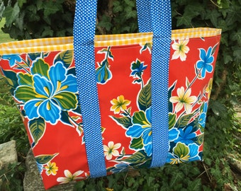 hibiscus patterned floral oilcloth tote bag on tomato red