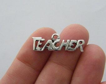 8 Teacher charms antique silver tone M651