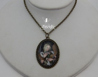 Dragon Embrace Necklace - antique bronze necklace with image of a princess holding a young dragon in front of a castle window - fantasy