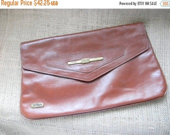 20% OFF SALE vintage. 70s Philippe Sienna Leather Clutch