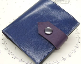 Blue leather wallet with 6 card slots, popper and grey inner