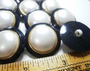 12 Buttons Black Gold with Pearly center -  1-1/8 each - 3 part snap together .