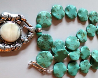 Vintage Nepalese Kathmandu turquoise colored round stone and silver shell amulet pendant necklace.