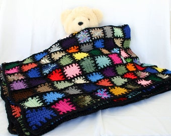 Scrap yarn afghan colorful crocheted lap throw blanket squares bedding long stitches patchwork quilt-style black edging border