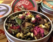 Rubythroated loose floral tea blend: full-sized canister