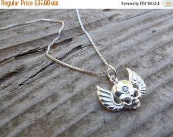 ON SALE Wing skull necklace made in sterling silver with a cz