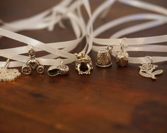 princess themed cake pulls.  set of seven sterling silver birthday cake charms by kellylynndesigns on etsy.com
