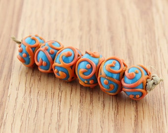 Sheribeads Glass Beads 6 Orange Raised Scrolled Dark Turquoise Rondels Lampwork