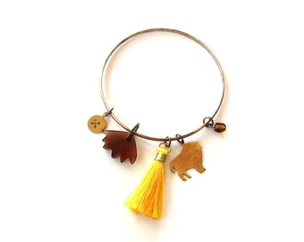 custom initial buffalo bracelet . personalized charm bangle bracelet with yellow tassel, swarovski crystal and crossed arrows, your letters
