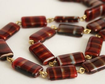 Vintage red and brown glass bead necklace.  Striped glass beads