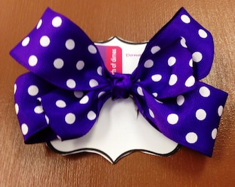 Purple polkadot hair bow