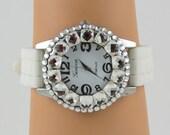 Geneva Platinum Wrist Watch, Quartz, Japan, Silver, White plastic sports band, Rhinestone encrusted, Runs, Excellent condition, Battery
