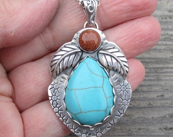 Turquoise Magnesite and Goldstone Sterling Silver Pendant
