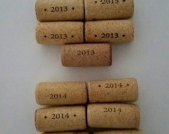 15 natural corks from wines, dated with years 2010, 2012, 2013, & 2014