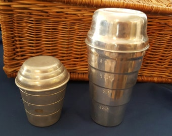 Two Vintage Tin Measuring Shakers