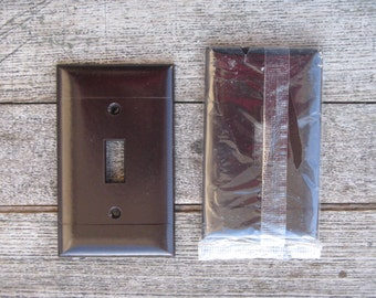 mid century toggle switchplate cover brown bakelite new old stock smooth surface without screws