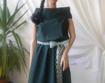 Ladies pinafore dress made of cotton oil green.