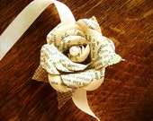 wrist corsage made from vintage book pages recycled alternative wedding prom formal pearl center