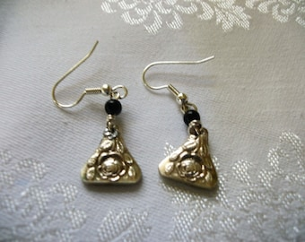 A very pretty pair of earrings made from antique silverware