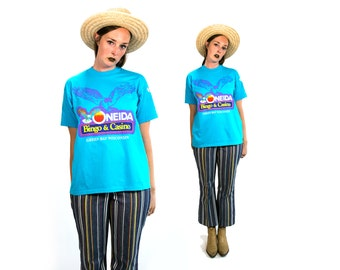 Vintage 1990's 90's Ojibwa Bingo and Casino Green Bay Kitsch Funny Tee Shirt Unisex Gamlble Vtg Bright Blue Short Sleeved Size Large Unisex