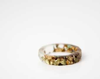 eco resin ring, transparent size 5.5 thin multifaceted eco resin band ring with varigated metal flakes