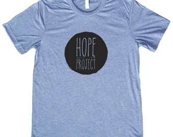 Hope Project Black Circle Logo T Shirt - Feed a child in Nicaragua by purchasing this stylish tee - 3 Colors to choose from