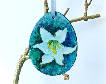 One Easter egg hanging ornament, decoration, hand painted with a white Lily