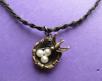 Bird Nest Charm Necklace - Unique nest charm with bird and eggs - on 3 strands of braided camo micro paracord. Length is adjustable