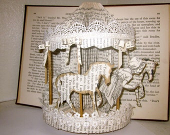 Altered popup book sculpture  a carrousel ride Children of Charles Dickens book