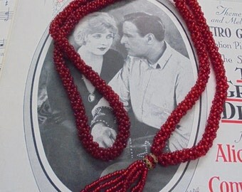Red crocheted rope necklace with tassel