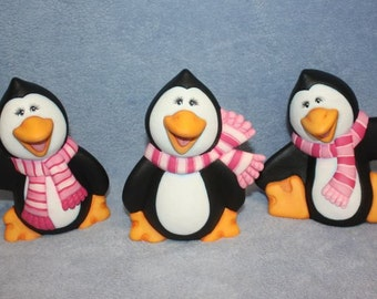 Handpainted ceramic Penguin Trio Chilly, Silly & Willy Penguin all wearing pink and white scarves