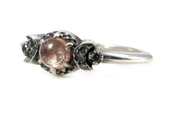 Pastel Pink Oregon Sunstone Moon Ring With Golden Schiller and Black Diamonds - Sterling Silver