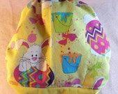 SassyCloth one size pocket diaper with Easter bunnies on yellow cotton print. Ready to ship.